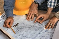 Contractors with drawing