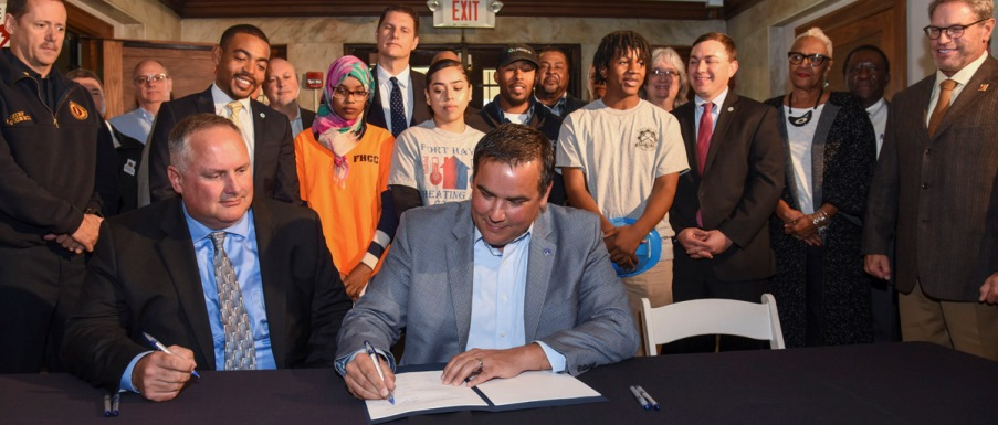 Community benefits signing photo